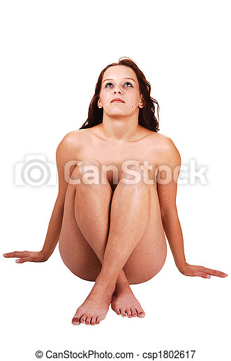 Woman sitting naked om