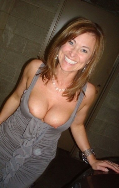 Boobs slip out in public